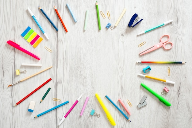 Back to school concept, creative layout with with various school supplies on wooden background