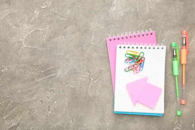 Back to school concept on grey concrete background. top view