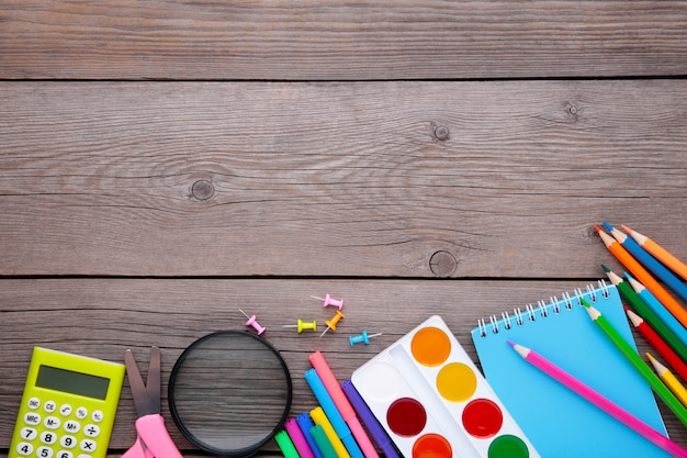Back to school concept on grey wooden background