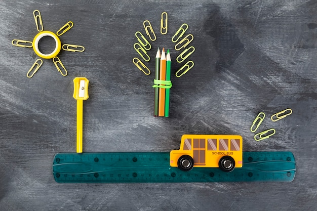 Back to school concept. imitation of trip to school on school bus, flat lay