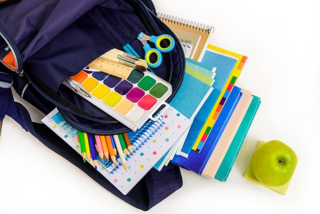 Back to school concept. notebook stack and school pencils. schoolchild and student studies accessories.