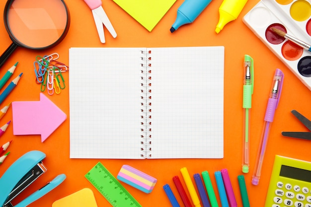 Back to school concept on orange background. top view