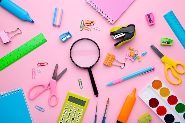 Back to school concept on pink background, top view