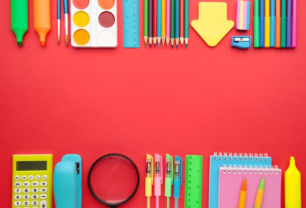Back to school concept on red background. top view
