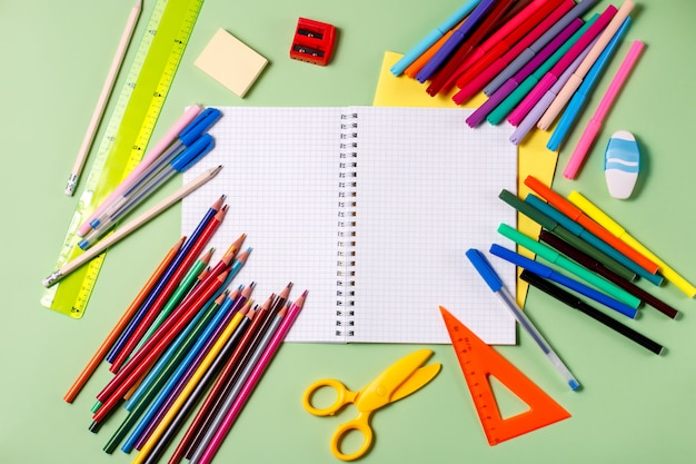 Back to school concept. school supplies on a pastel background