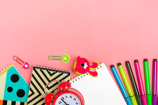 Back to school concept. school supplies on pink, flat lay.
