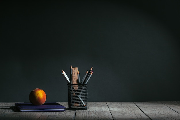 Back to school concept. stationery with fruit on the table