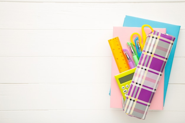 Back to school concept on white wooden background. top view