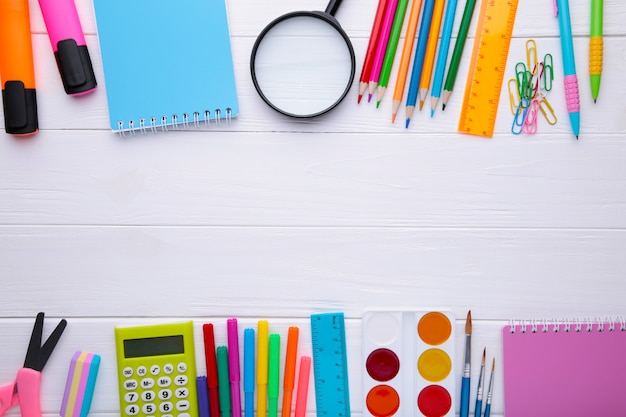 Back to school concept on white wooden background