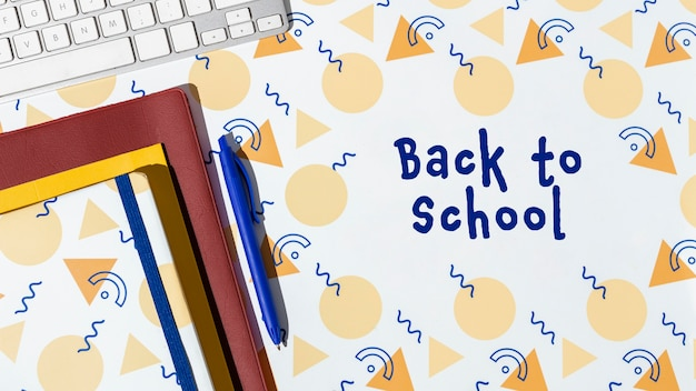 Back to school concept with notebooks and keyboard