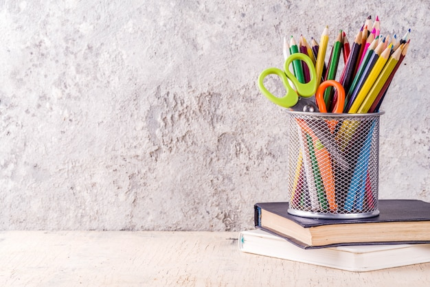 Back to school concept with pencils, school supplies and books