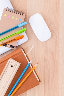 Back to school concept with school supplies on wooden table .