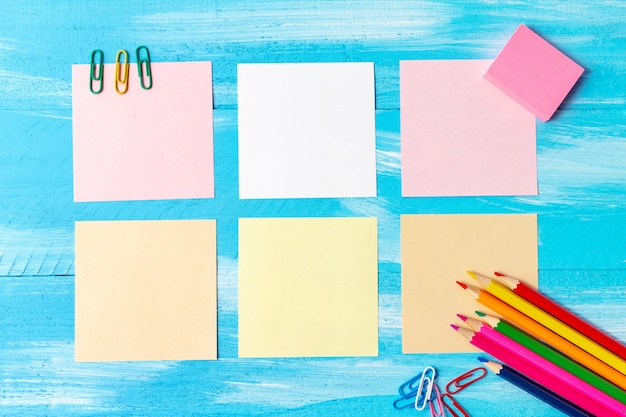 Back to school concept with stationery office supplies pens, pencils, brushes, felt pens, markers, paper clips