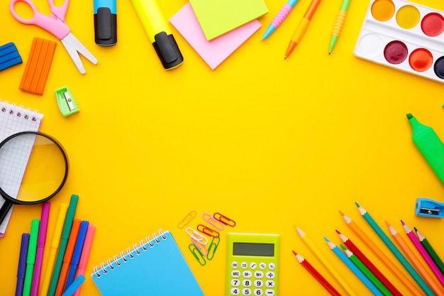 Back to school concept on yellow background with copy space