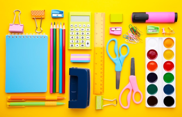 Back to school concept on yellow background