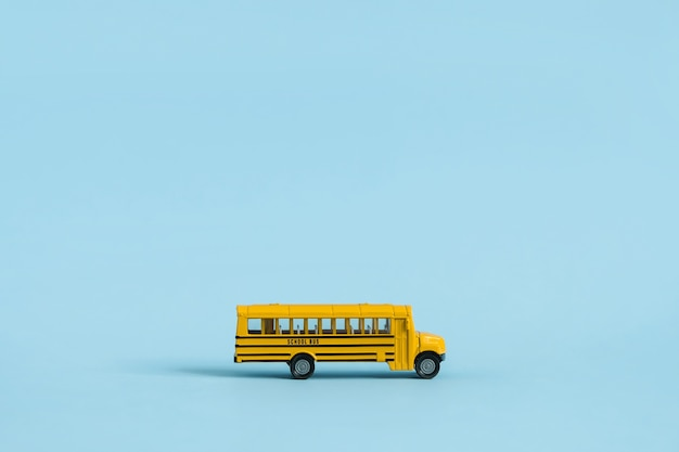Back to school concept. yellow toy model school bus