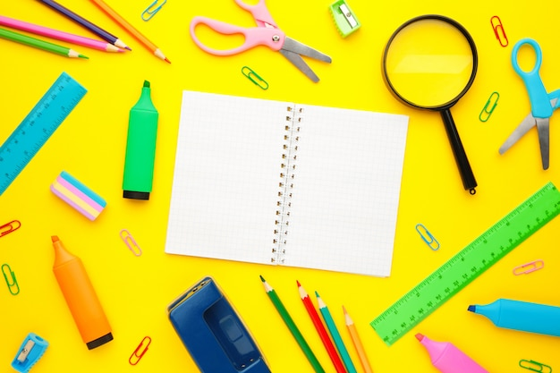 Back to school concept on yellow wall. top view