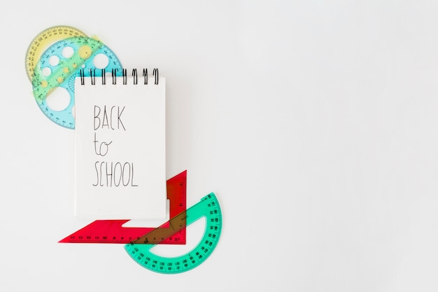 Back to school decoration with notepad and set squares