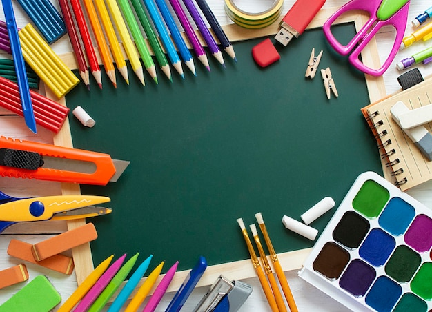 Back to school. education concept. blackboard and stationery. place for text