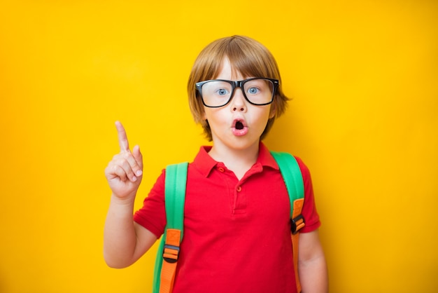 Back to school. first grade junior lifestyle teen concept. close up studio photo portrait of cute boy gesturing up