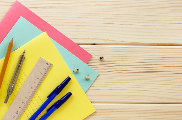 Back to school flat lay. stationery on a light wooden background, top view
