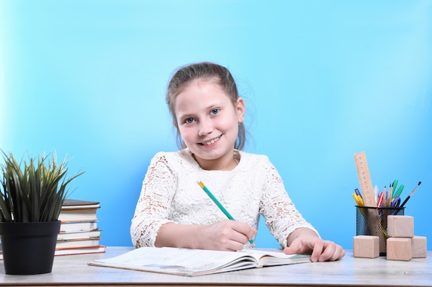 Back to school .happy cute industrious child is sitting at a desk indoors. kid is learning in class.quarantine.kid is learning in home.