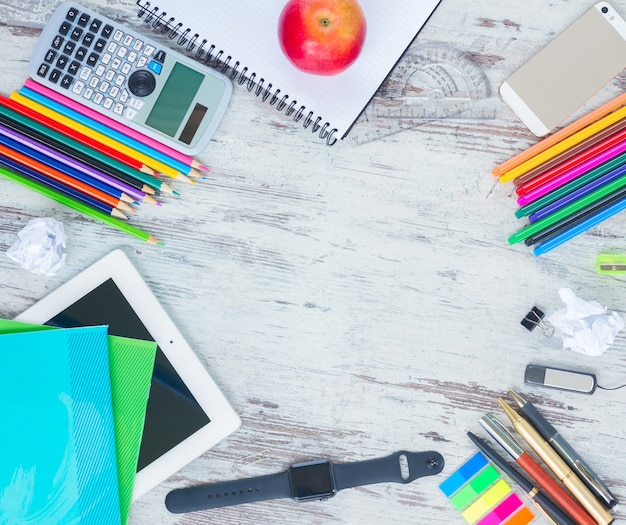 Back to school hero header with school supplies on wooden table