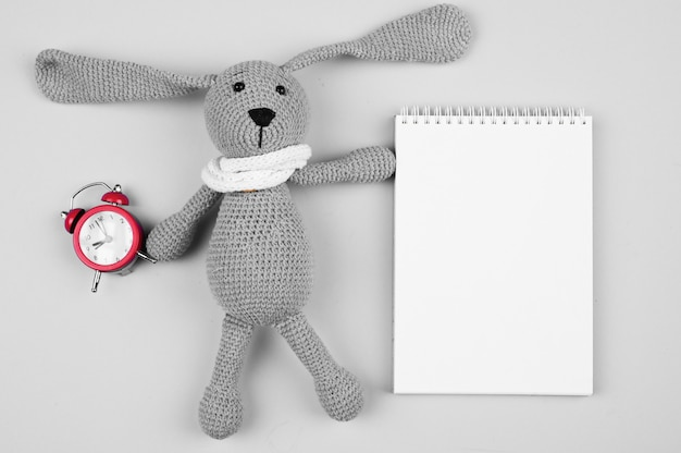 Back to school mock up with alarm clock and bunny
