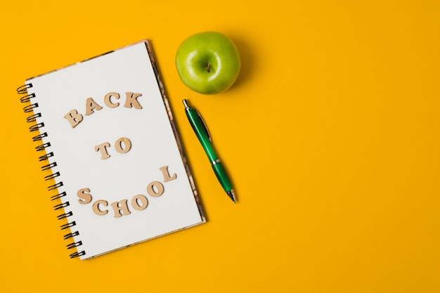Back to school notepad with orange background