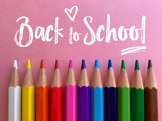 Back to school, pencils in pink background