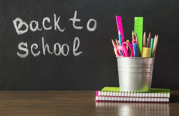 Back to school. school supplies, copybook and pen.