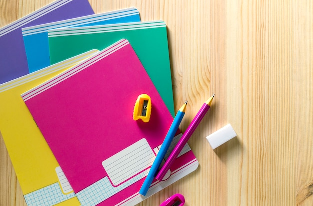 Back to school. school supplies on a wooden board.