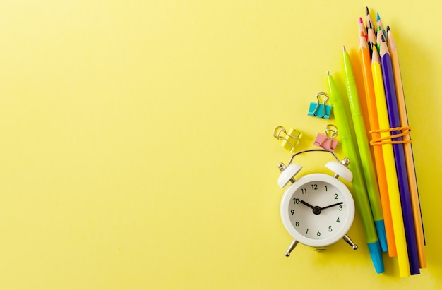 Back to school. school supplies on a yellow paper background. copy space