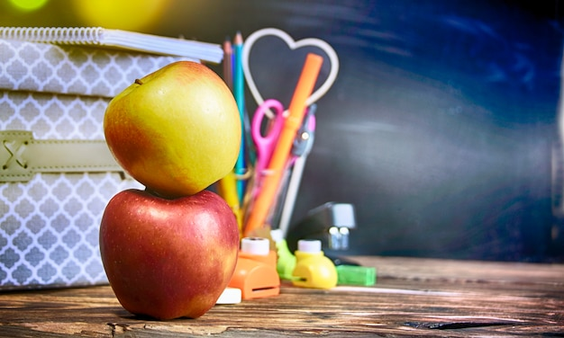 Back to school, supplies and blackboard.