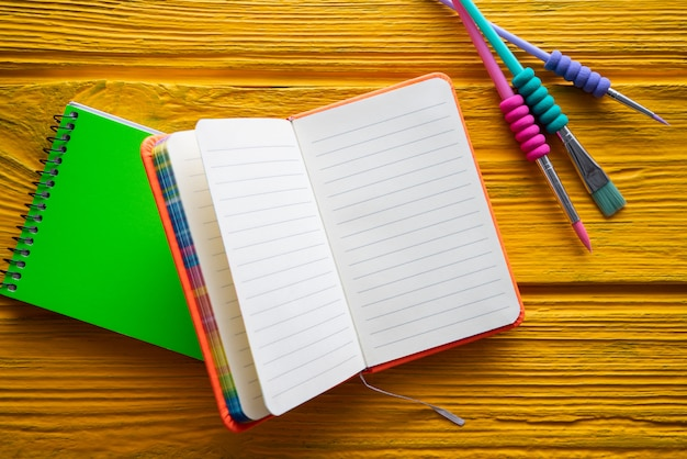 Back to school supplies notebook an brush