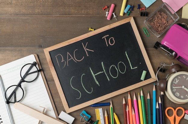 Back to school text on black chalk board