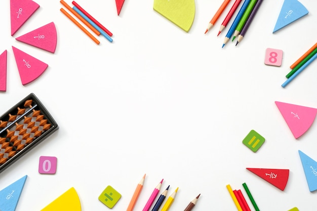 Back to school white background with place for text. mathematics education equipment tools.