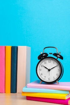 Back to school with books and alarm clock