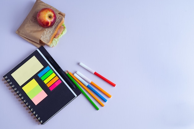 Back to school with notebook, pencils and sandwich with fruit. copy space.