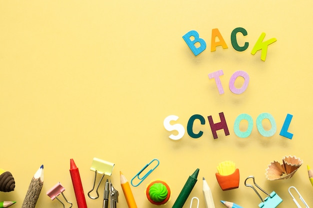 Back to school wood text arrange on yellow background