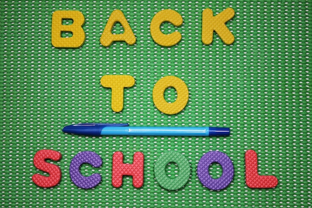Back to school words are lined with colored letters