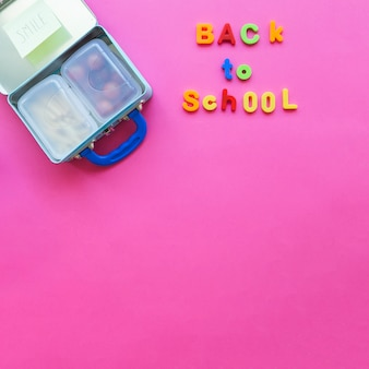 Back to school writing near lunchbox