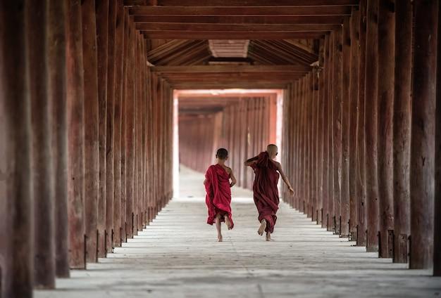Back side of buddhist novice are walking in pagoda,myanmar