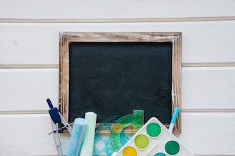 Back to school composition with slate and artistic elements