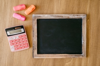 Back to school concept with slate, calculator and pens