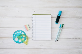 Back to school decoration with notepad and school objects