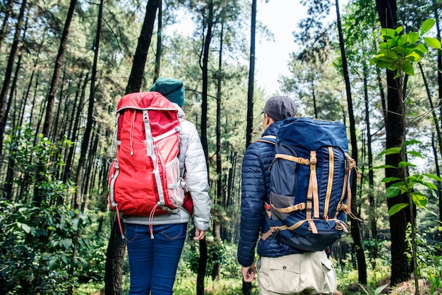 Back view of asian backpacker couple traveling together