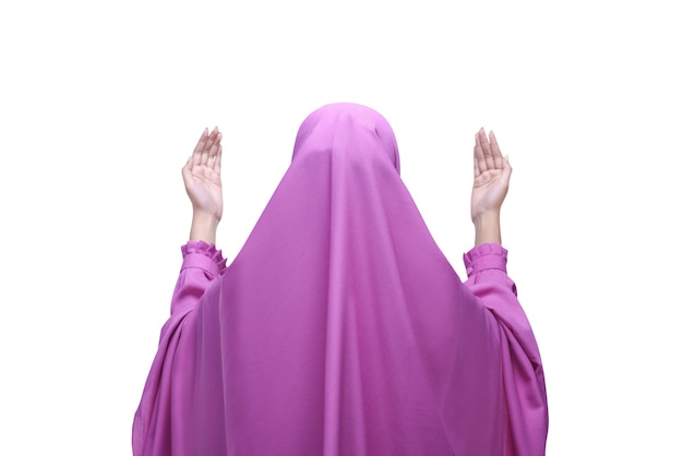 Back view asian muslim woman with veil praying