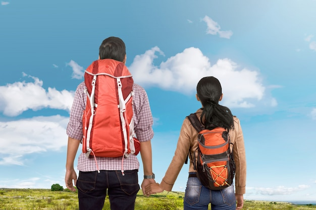 Back view of asian traveler couple looking at view together