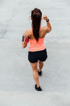 Back view of athlete exercising